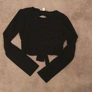 Small black crop top with open back and tie
